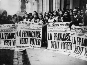 "Young French feminists demonstrate with the posters that state: ""French Women want to vote"". Paris. Photograph. Around 1935."